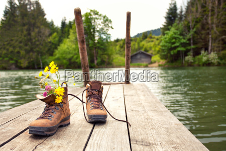 hiking boots at the lake
