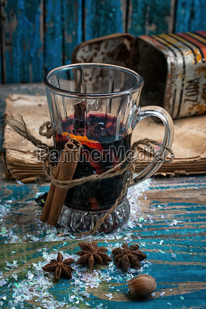 glass of mulled wine with spices