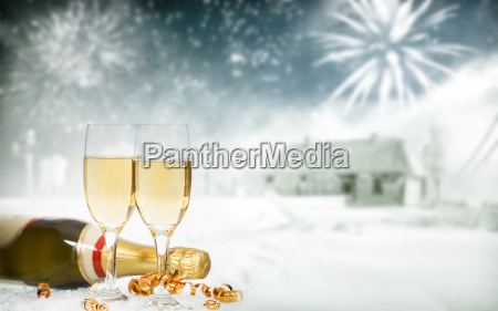glasses with champagne and bottle over