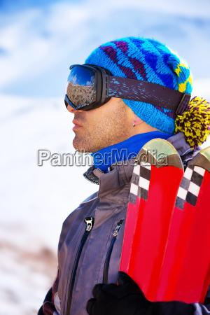 handsome man enjoys ski resort