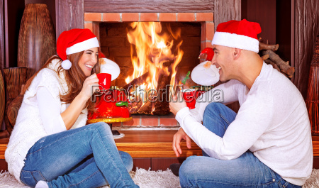 loving couple by fireplace
