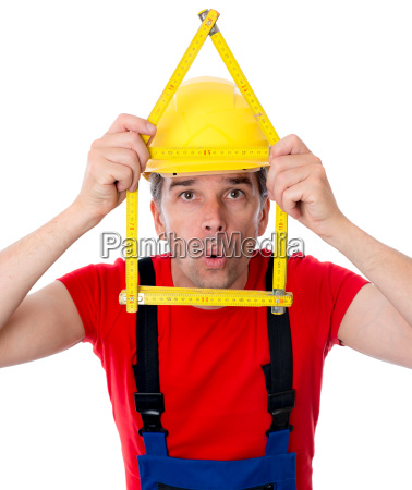 worker with folding yardstick house