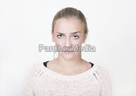 girl looks annoyed portrait