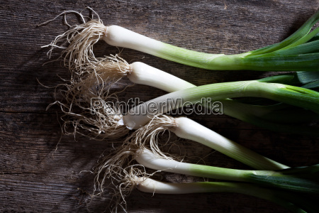 spring onions on wood
