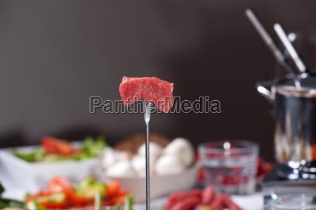 meat on fondue fork