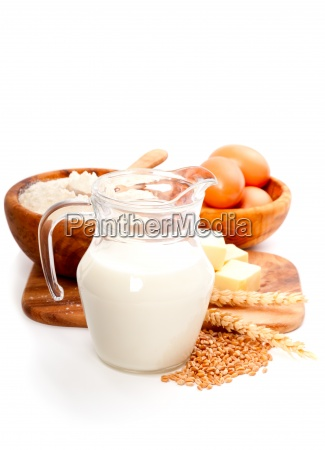 milk pitcher isolated with ingredients for