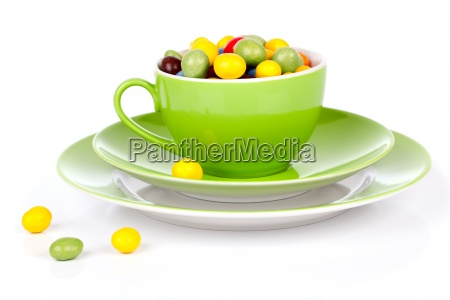 green cup with colorful candies