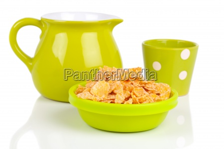bowl of cornflakes with a pitcher