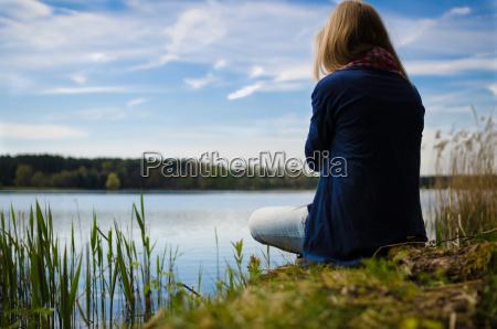 thinking at a lake
