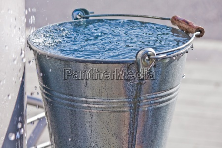 metal bucket with water droplets