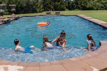 girls boy playing pool