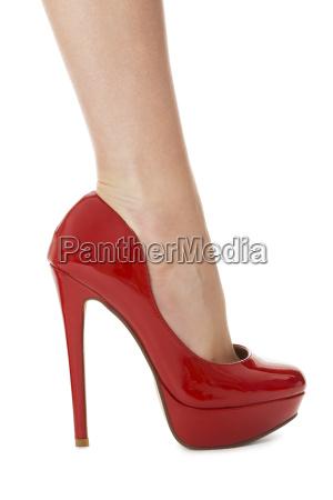 attractive female legs with red stilettos