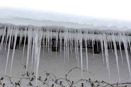 dangerous icicles on a house roof