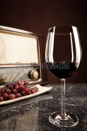 old radio grapes and a glass