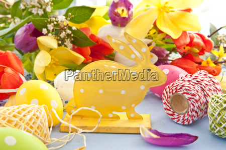 easter bunny in front of colorful