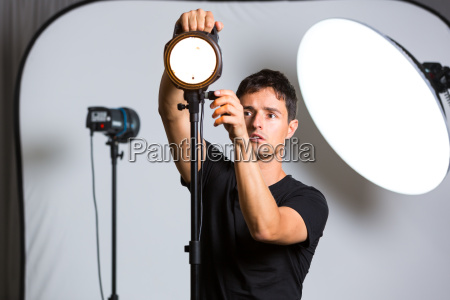 young pro photographer in his studio