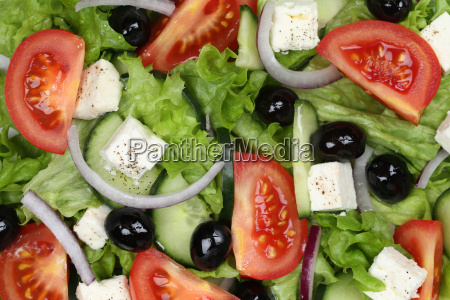 greek salad background with tomatoes feta
