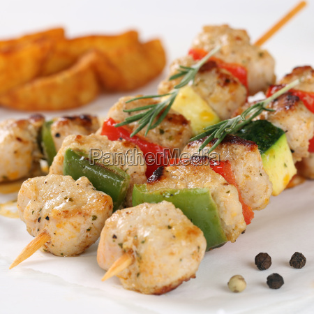 grilled meat skewers with potatoes