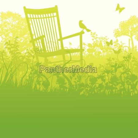 rocking chair in an outgrown garden