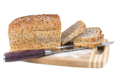 cut wholemeal bread and knife on