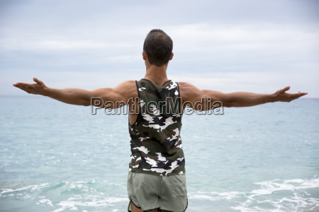 muscular young man on the beach