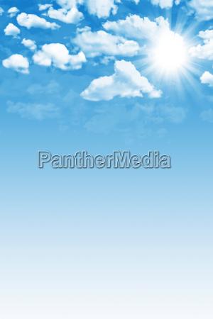 blue cloudy sky with sun