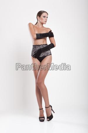 brunette slim girl in black lingerie