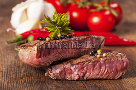 slices of steak on a wooden
