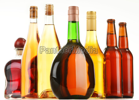 bottles of assorted alcoholic beverages isolated