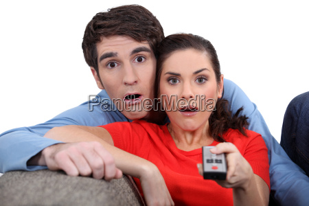 couple staring at the screen in