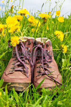 hiking boots in the grass