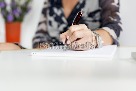 hand woman writing with pen and