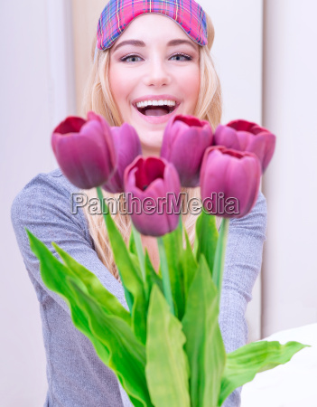 happy female with flowers