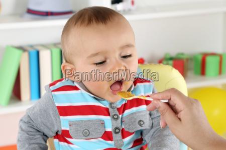 baby feeding with porridge