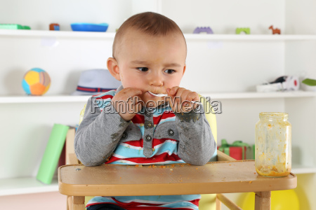 baby eating porridge with spoon