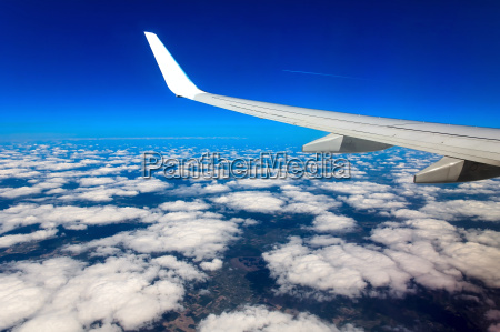 looking through window aircraft during flight