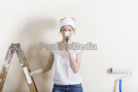 woman with brush in front of