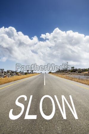 road with text slow