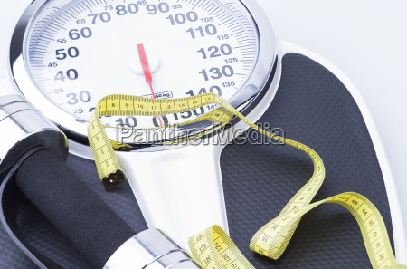 scales dumbbells and tape measure