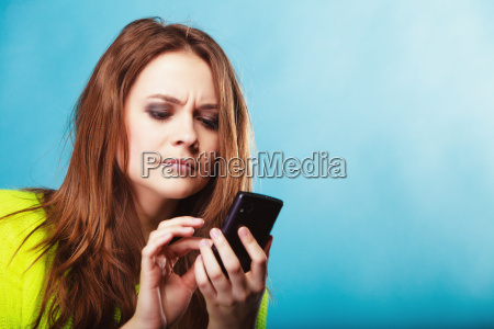 teenage, girl, with, mobile, phone, texting - 13420558
