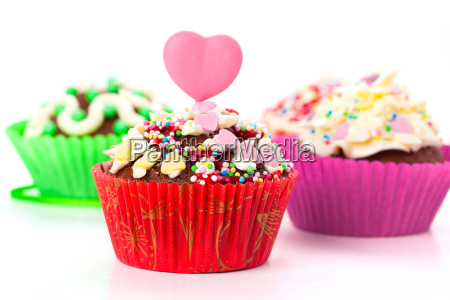 cupcakes with cream icing and a