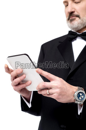 man reading news on his tablet