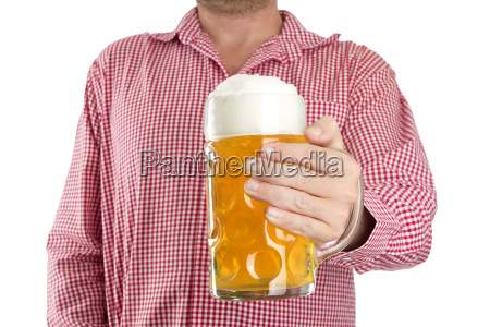 man in traditional bavarian shirt holds