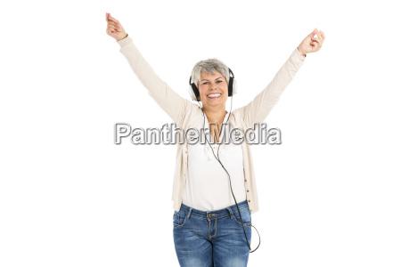 elderly woman listen music