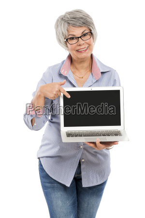 elderly woman showing something on a