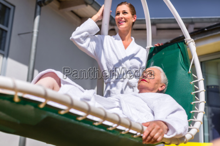 women relax on deck at the