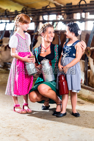 bavarian family with milk cans in
