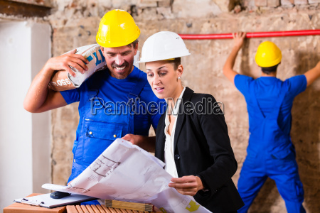 architect and construction workers on construction