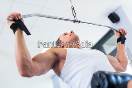 man with dumbbells doing exercise at