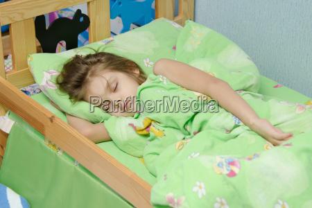 six year old girl sleeping in